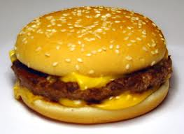 Hamburger with cheese and many millions of pathogenic germs